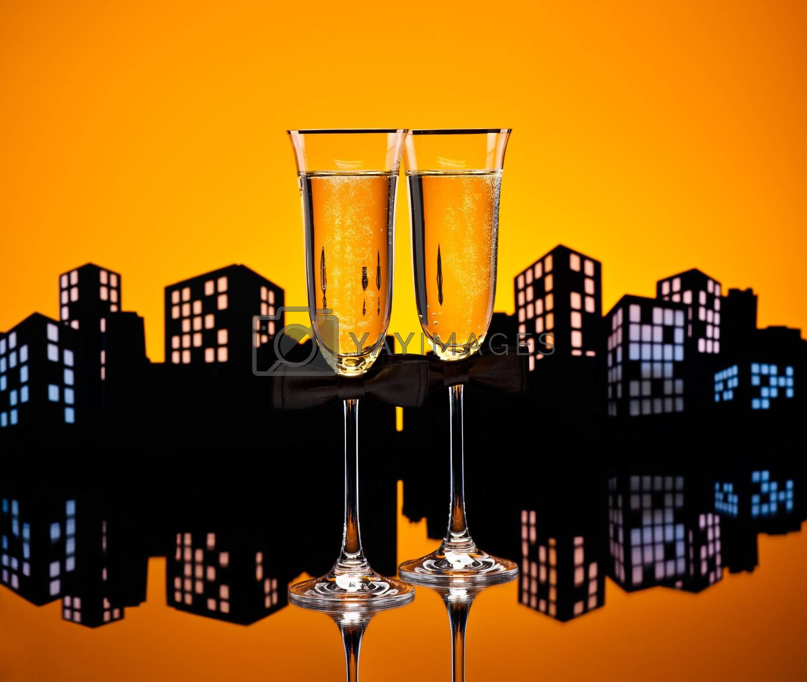 Metropolis champagne glasses with conceptual same sex decoration for gay men