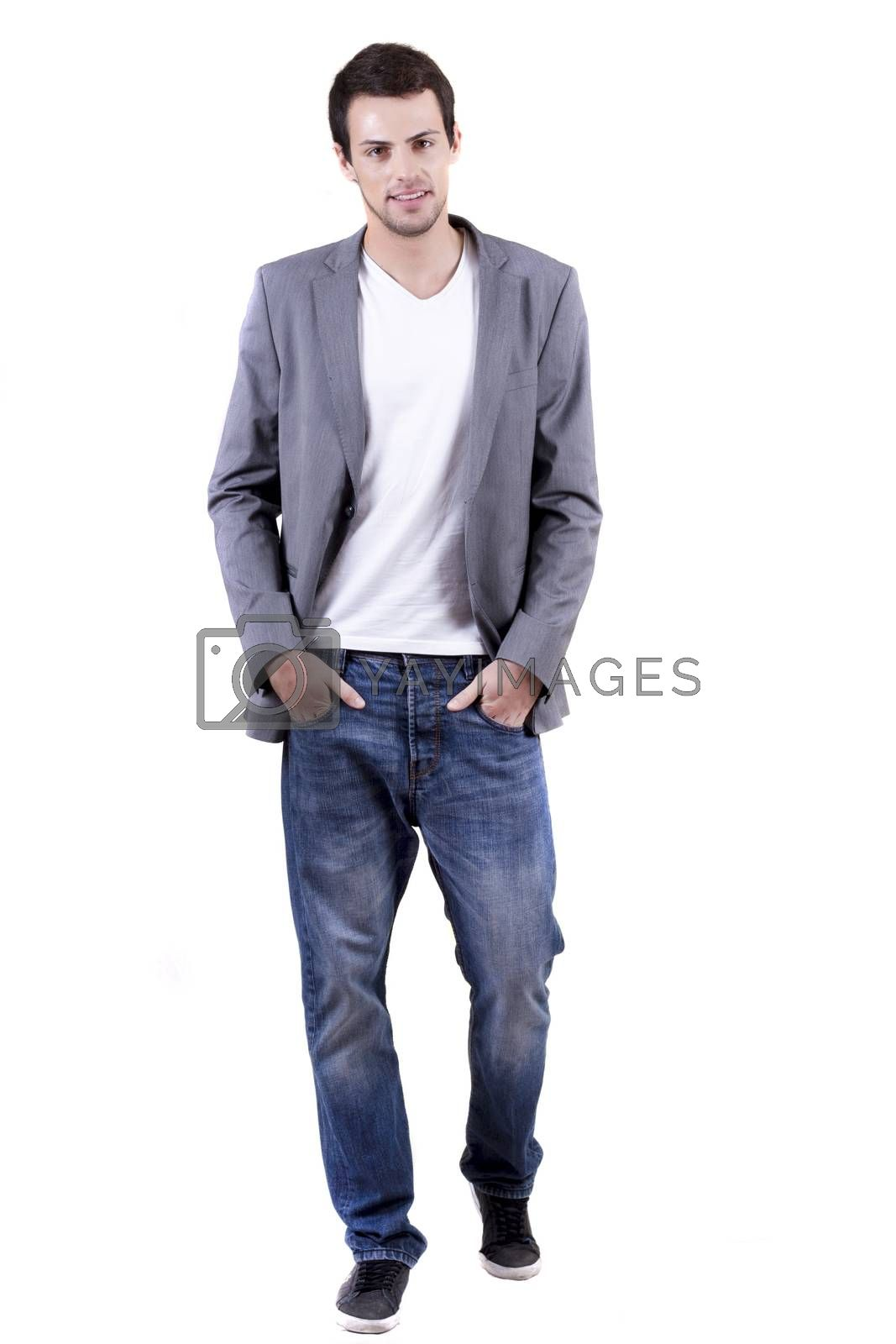 View of a young man walking on a white  background.