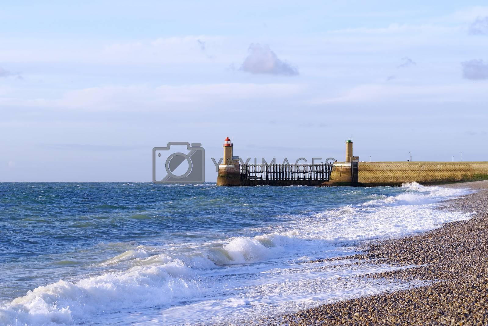 lighthouse ,blue ocean and beach
