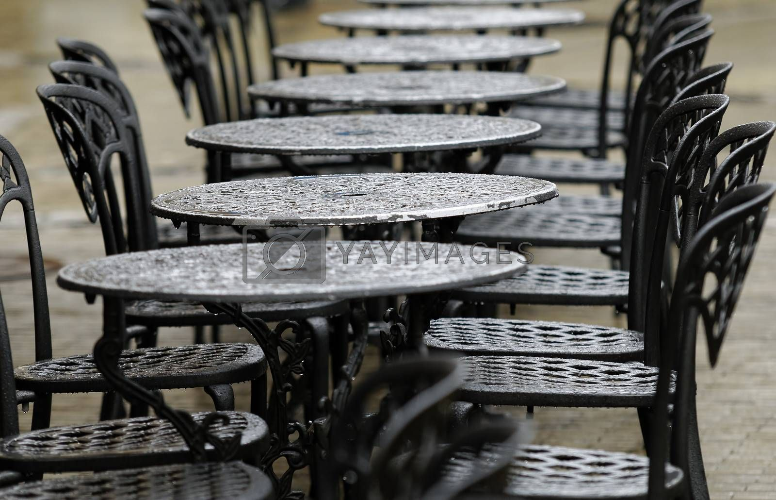 bistro tables on a rainy day