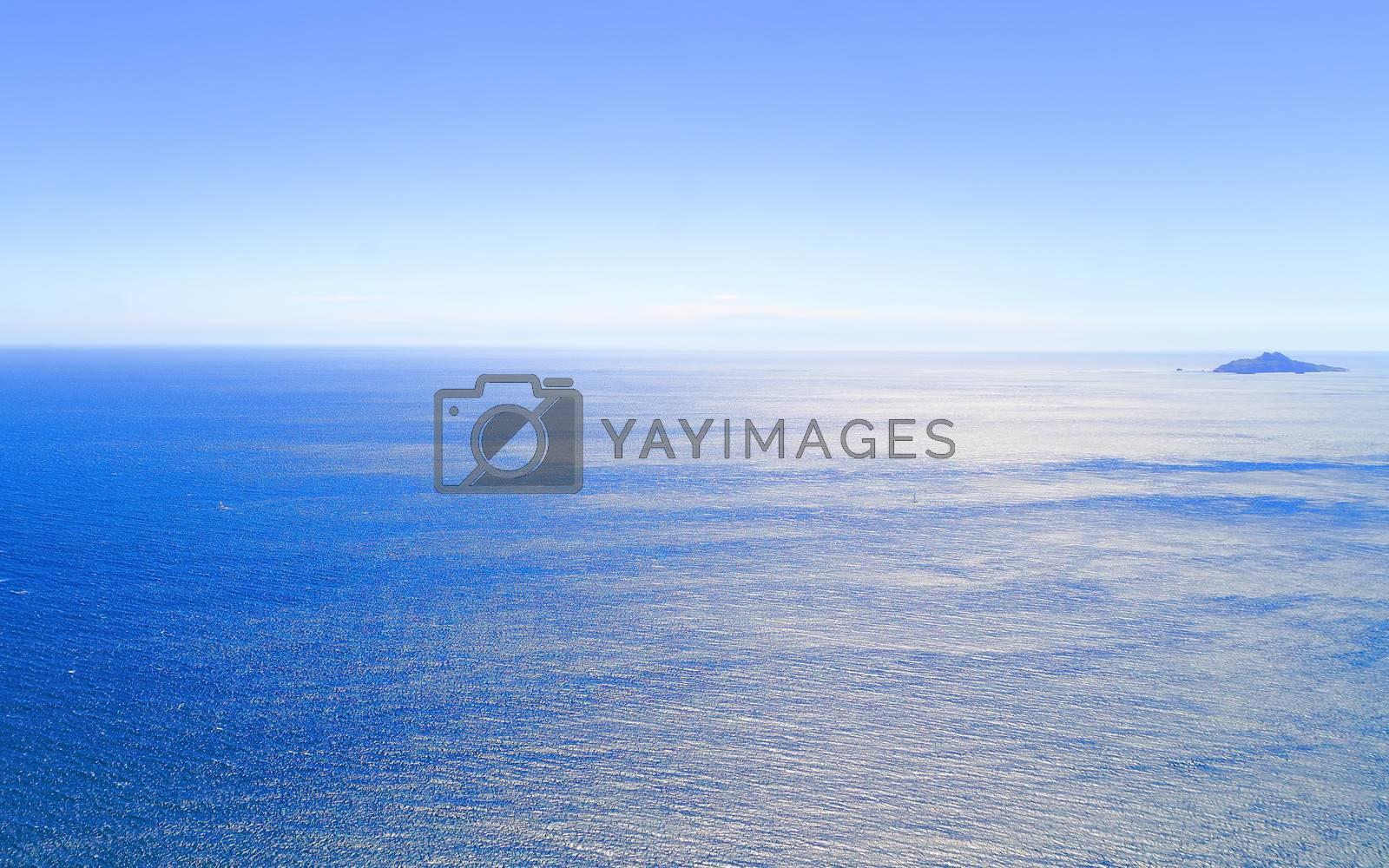 blue ocean and little island