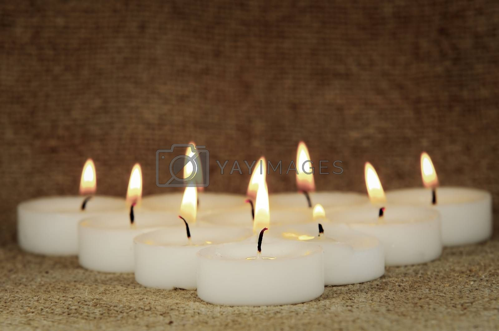 a group of burning candles