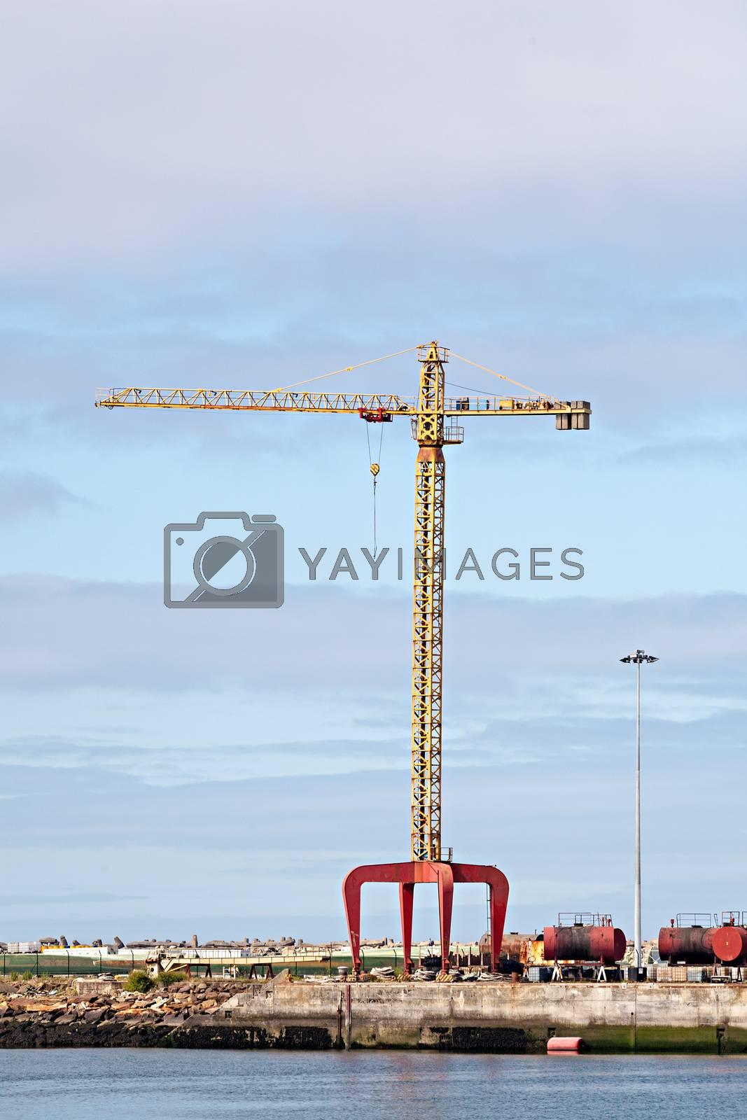 Photo of a crane at a cargo dock.