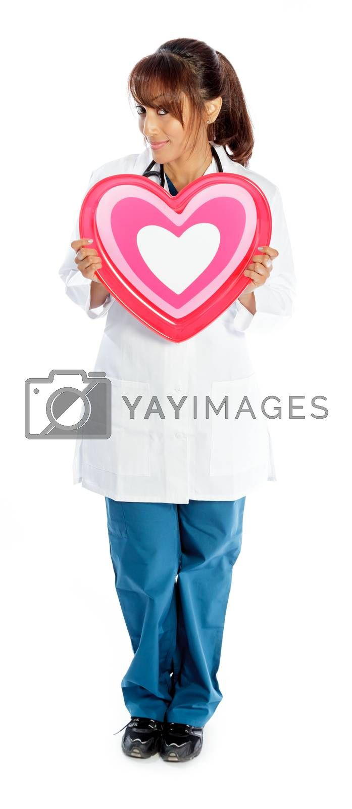 Attractive Indian doctor woman posing in a studio in front of a background
