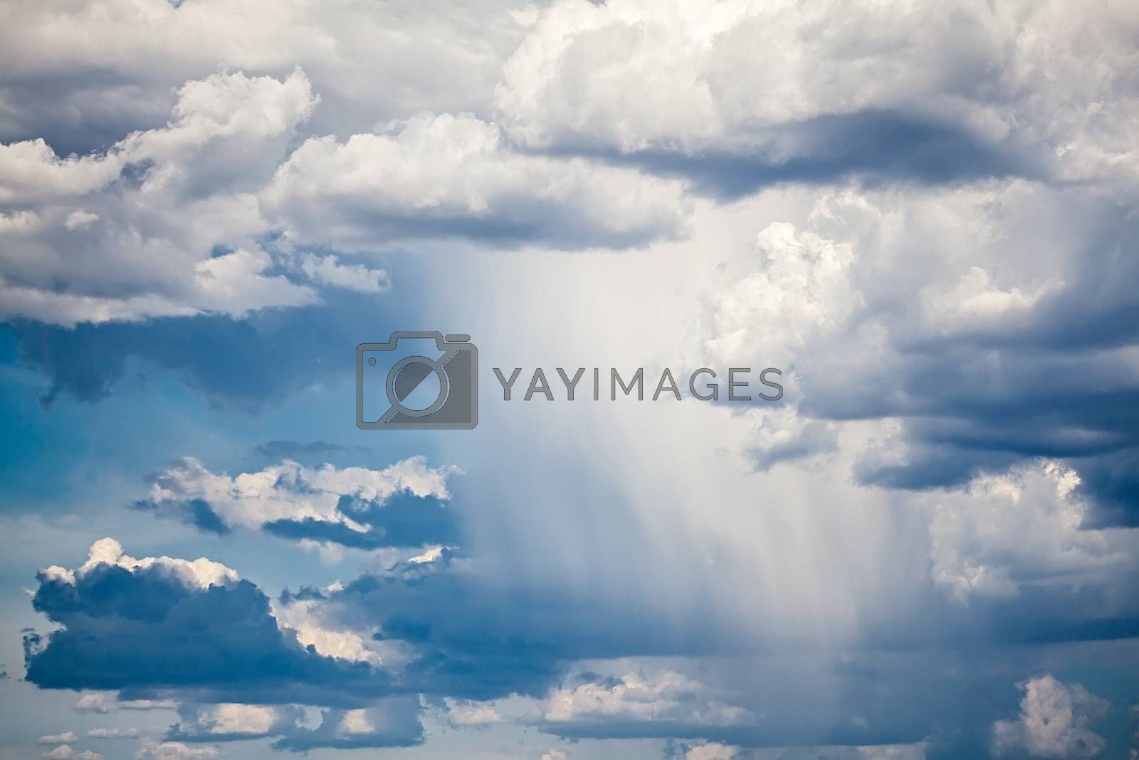 Photo of a dramatic sky with rain.