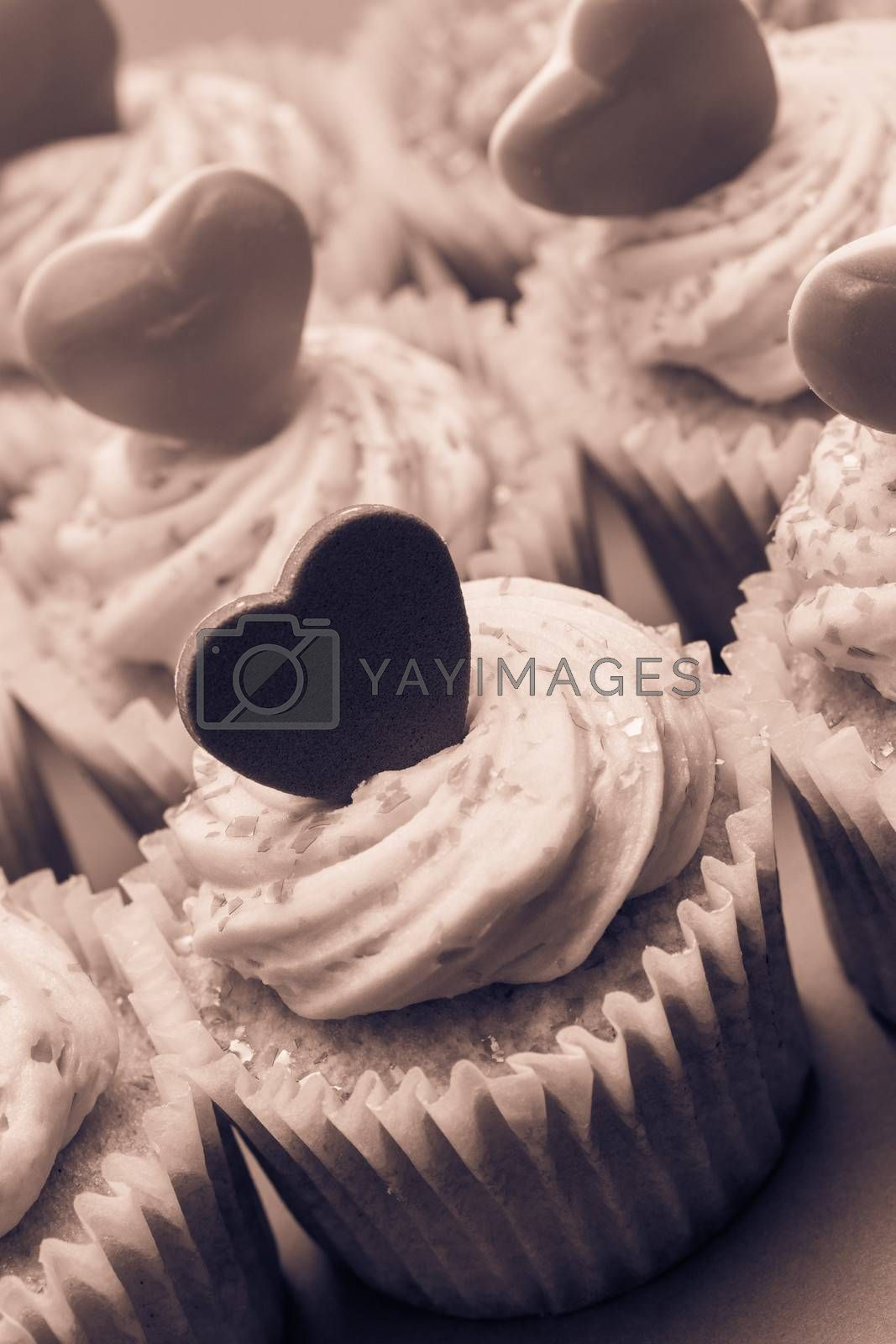 Close up of valentines cupcakes in sepia tint
