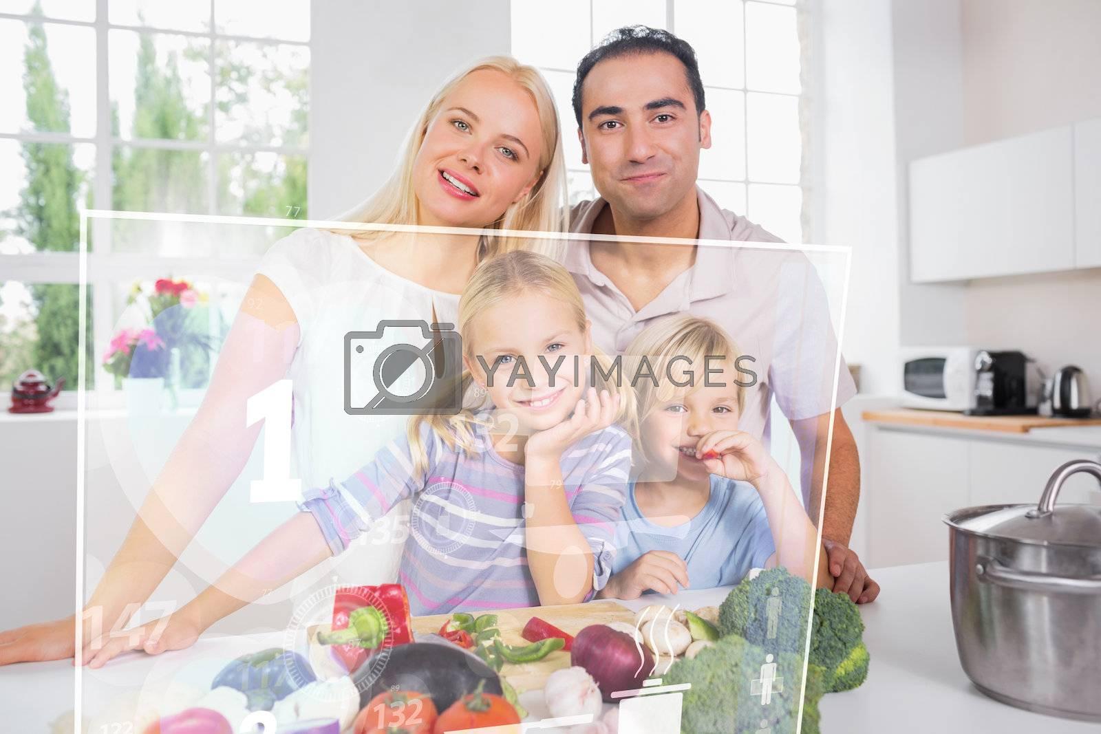 Happy family using futuristic interface to prepare dinner in the kitchen
