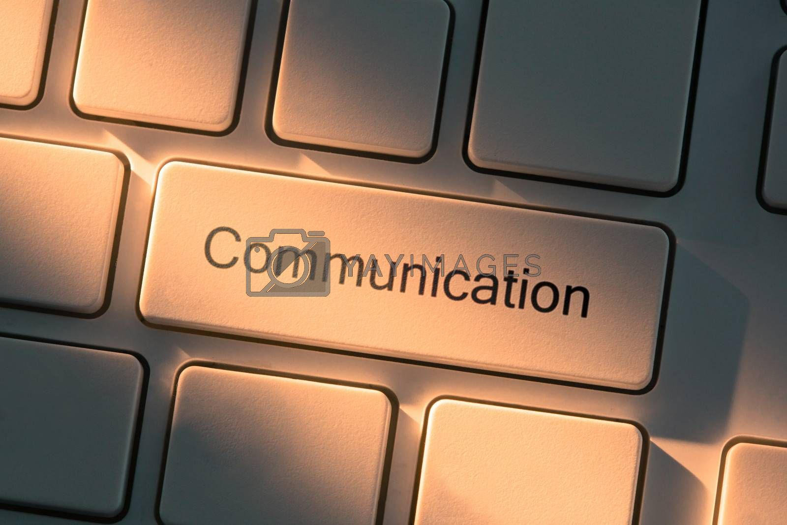 White keyboard with close up on communication button