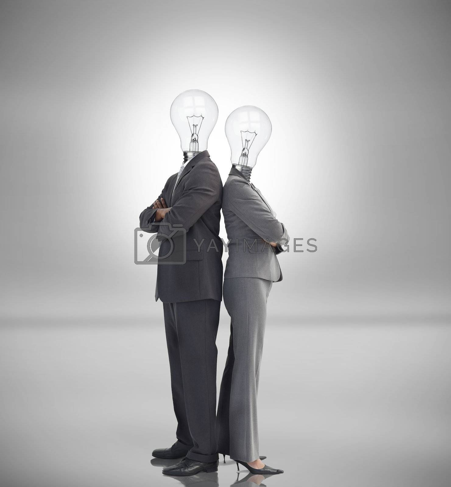 Business people with light bulbs instead of heads standing back to back
