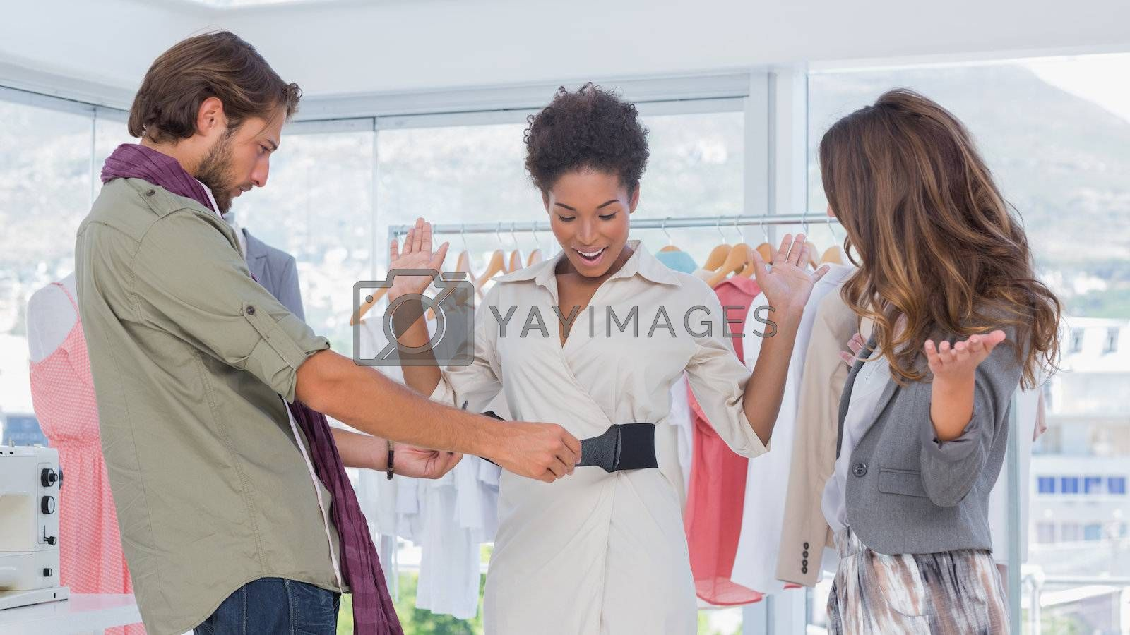 Cheerful model and fashion designers