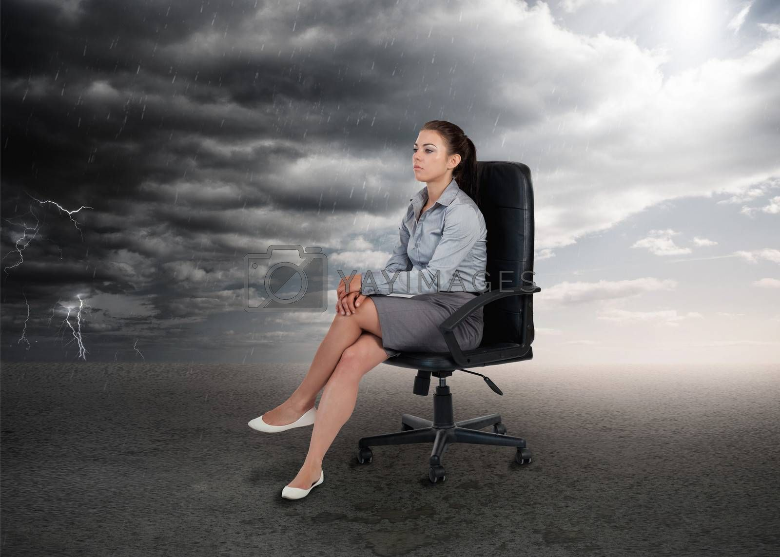 Businesswoman sitting in middle of opposite weather settings in a swivel chair