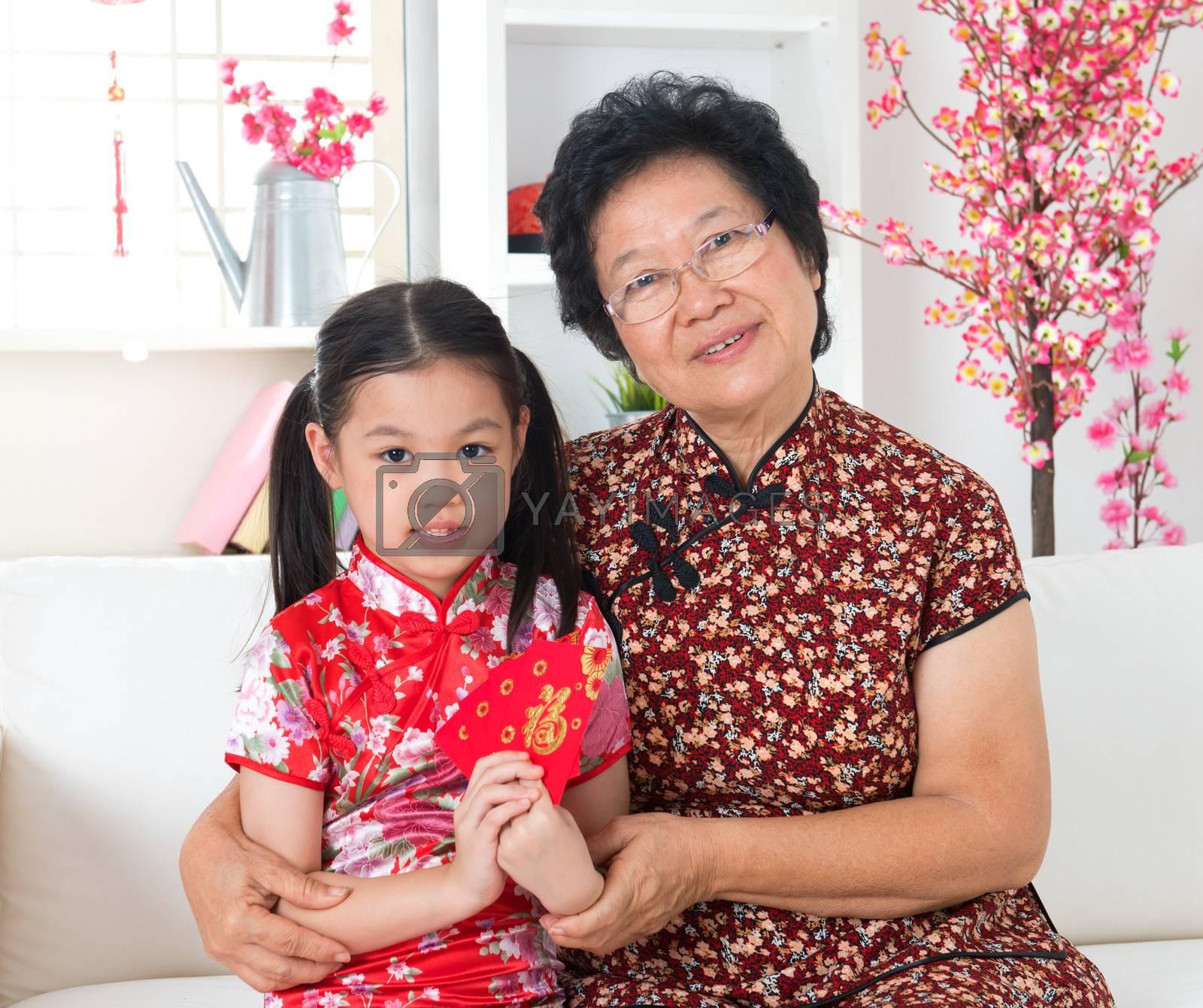 Beautiful grandparent and grandchild celebrate Chinese new year at home.
