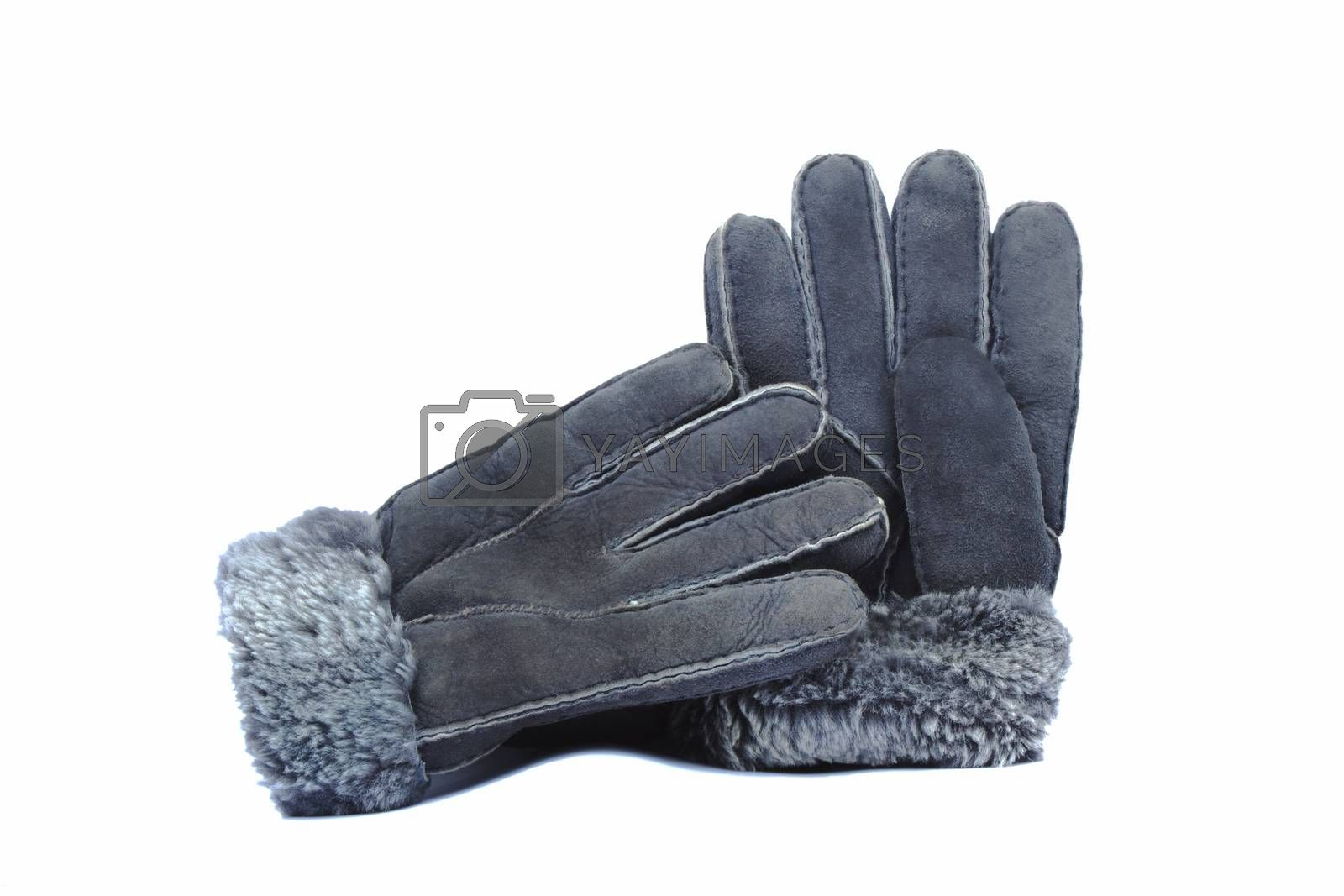 Warm winter gloves made of natural fur . Presented on a white background.