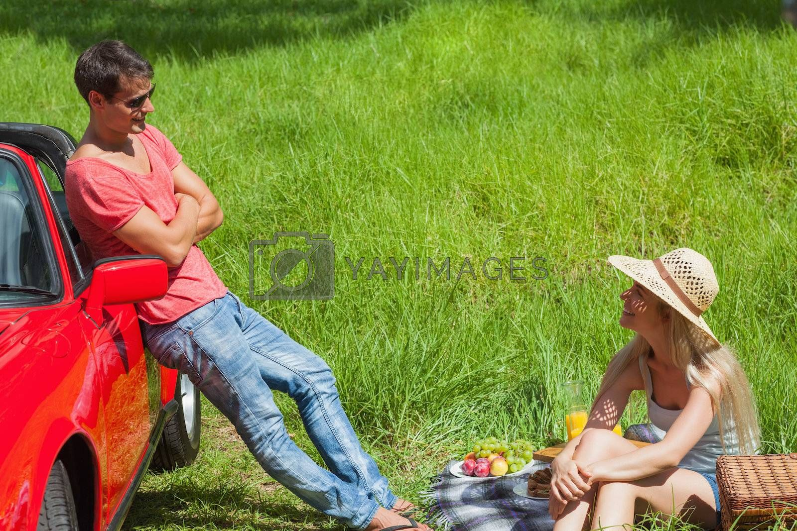 Cheerful couple having picnic together by Wavebreakmedia