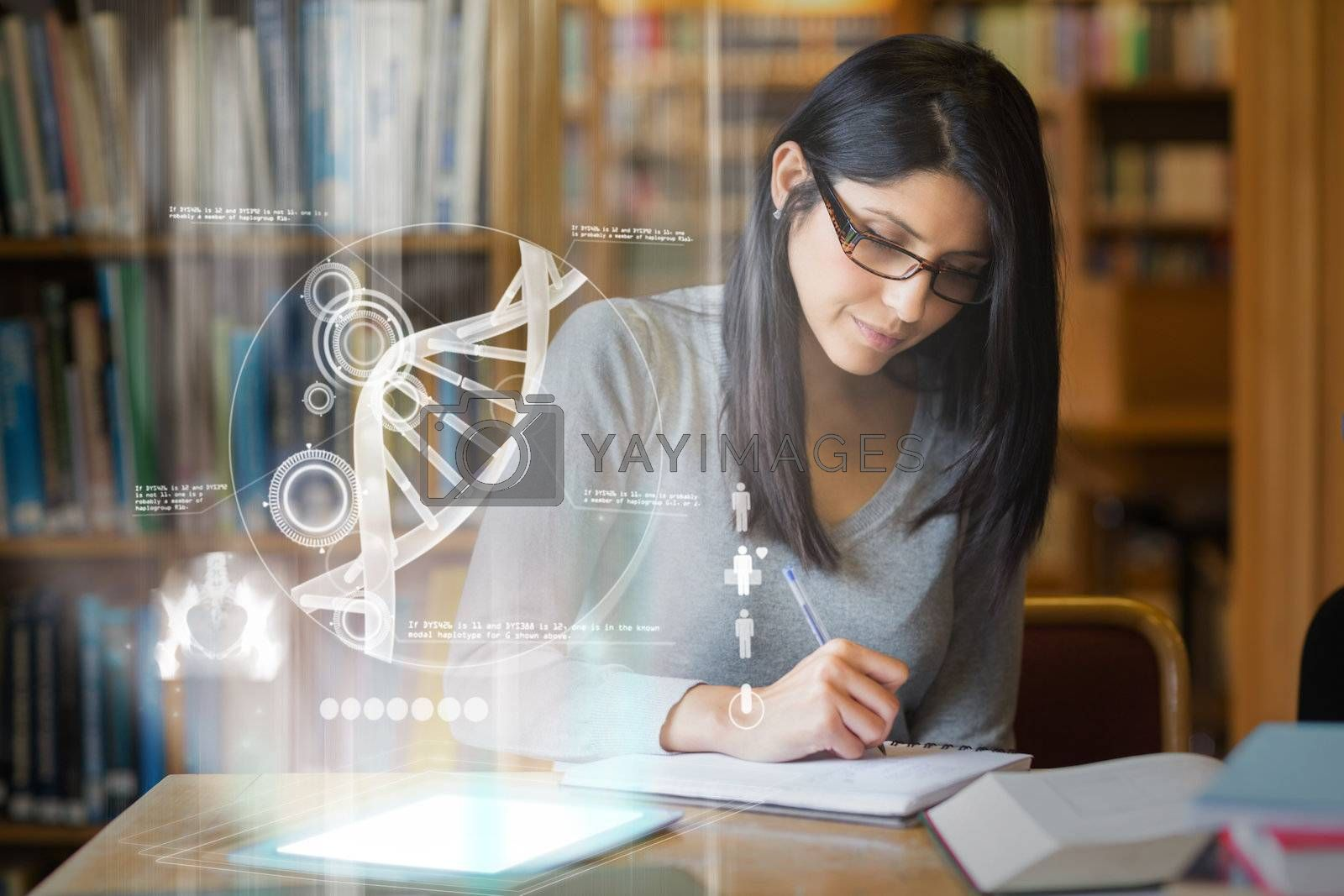 Focused mature student studying medicine on digital interface by Wavebreakmedia