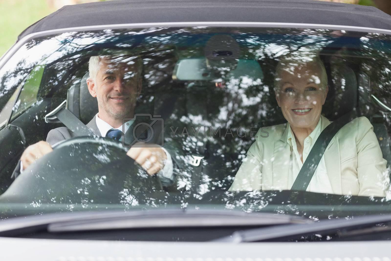 Business people having a ride in classy car by Wavebreakmedia