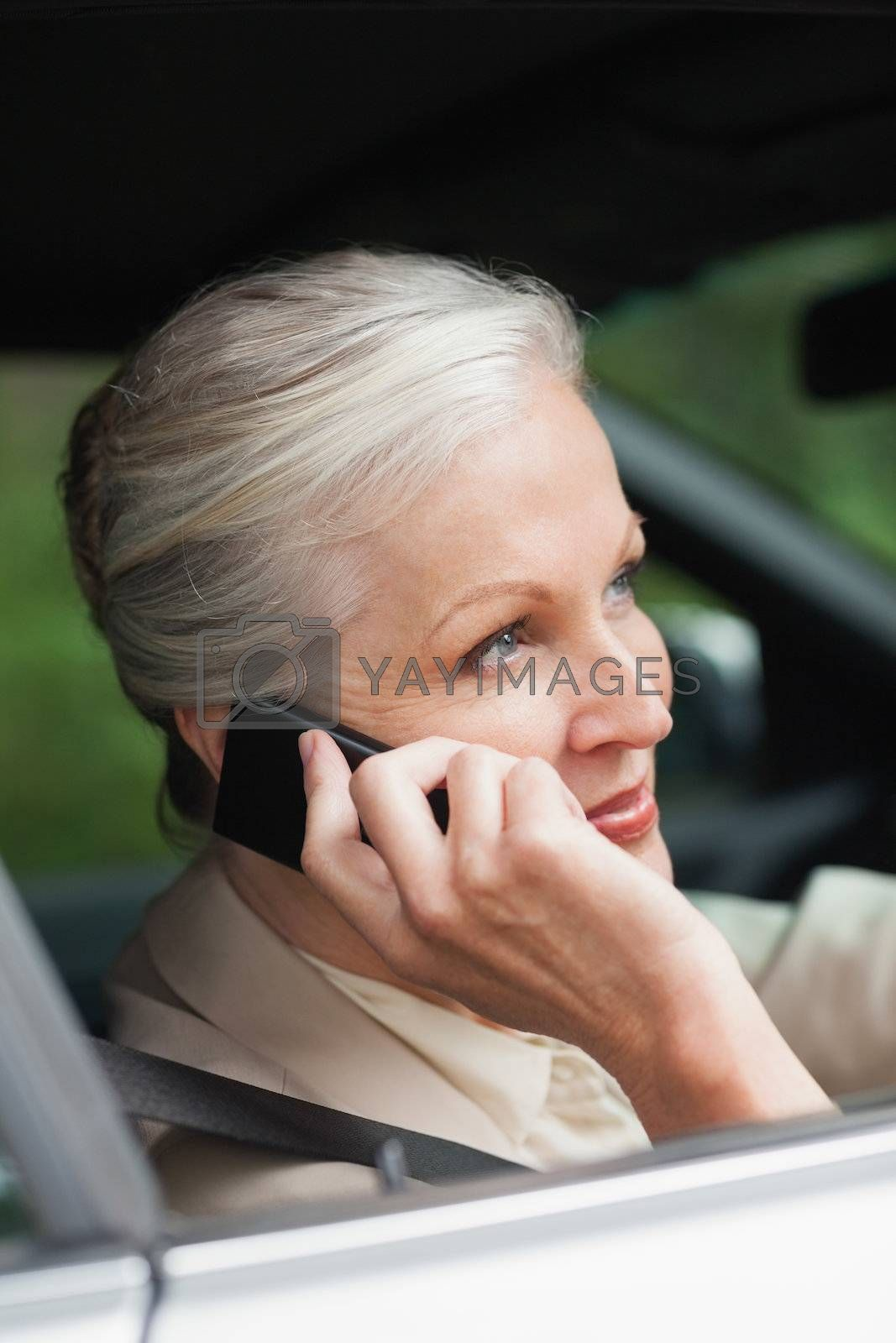 Peaceful businesswoman on the phone driving classy car by Wavebreakmedia