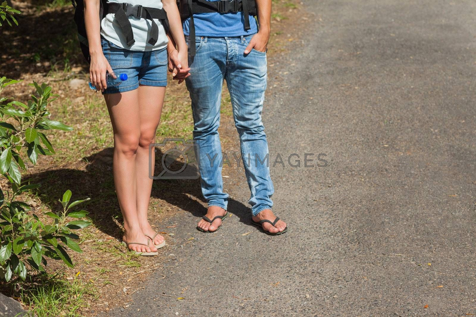 Legs of couple going for a trek together by Wavebreakmedia