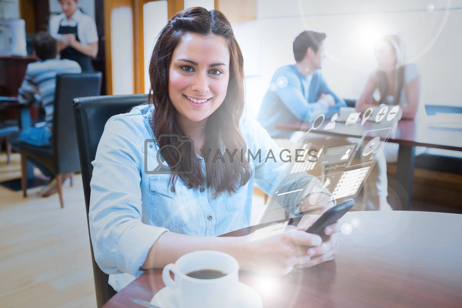 Smiling young woman studying on futuristic smartphone by Wavebreakmedia