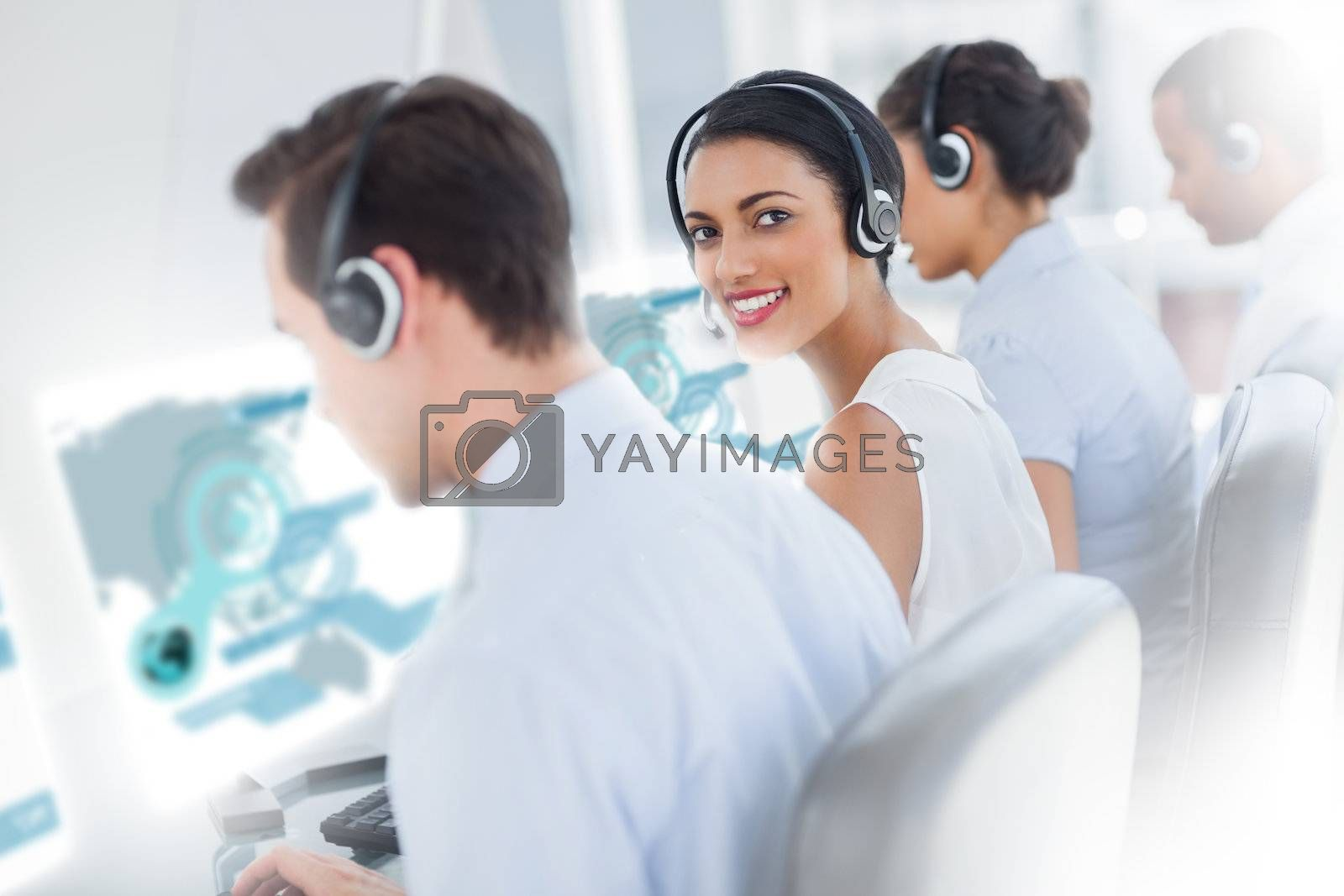 Pretty call center worker using futuristic interface hologram by Wavebreakmedia