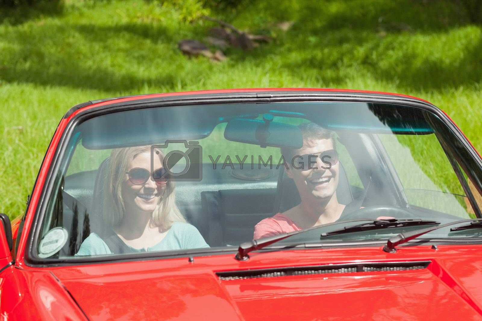 Happy young couple going for a ride together by Wavebreakmedia