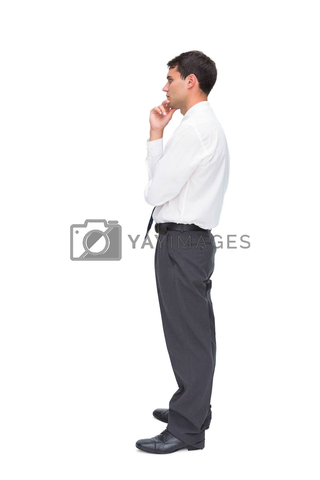 Thoughtful young businessman looking away by Wavebreakmedia
