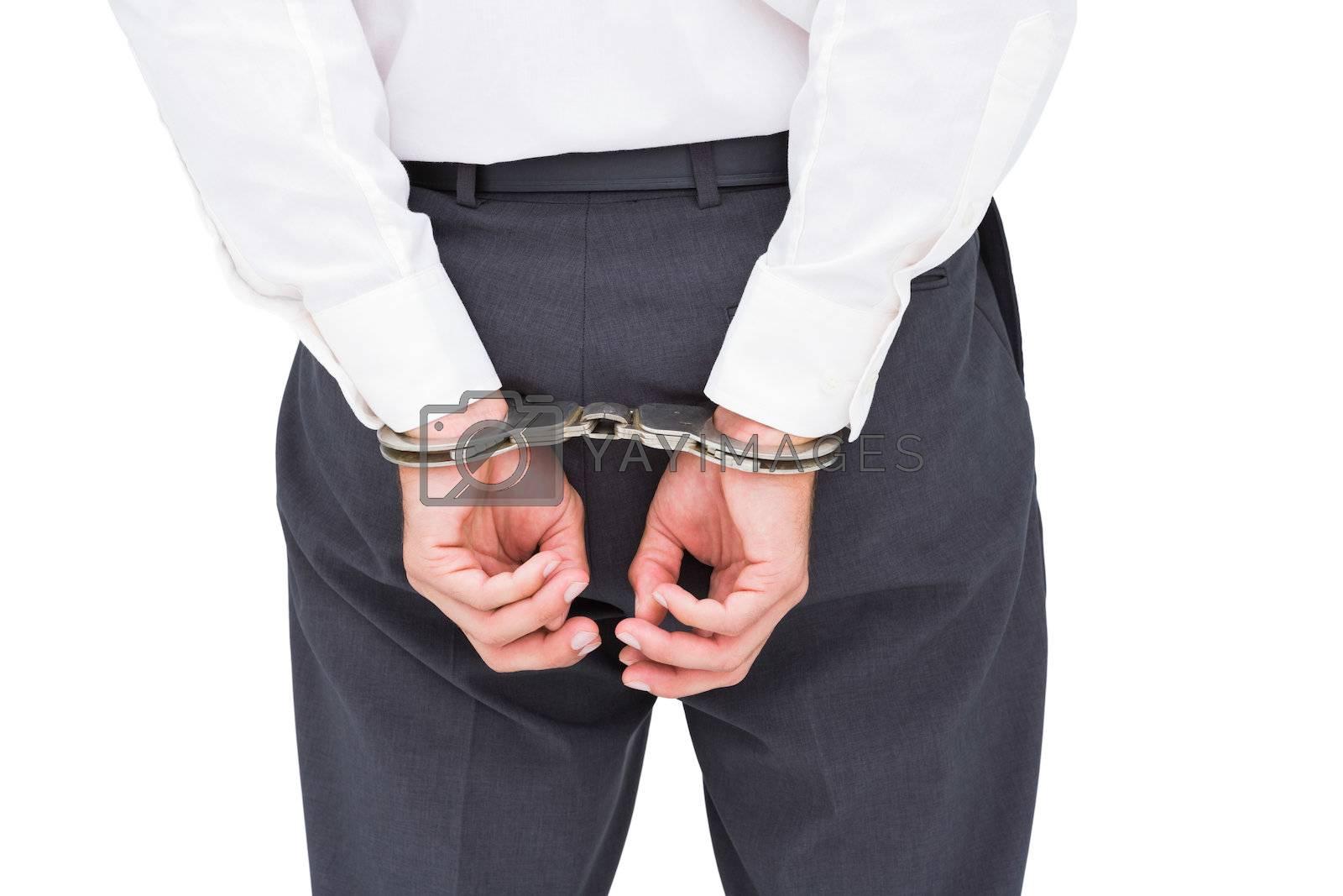 Close up on classy businessman wearing handcuffs by Wavebreakmedia