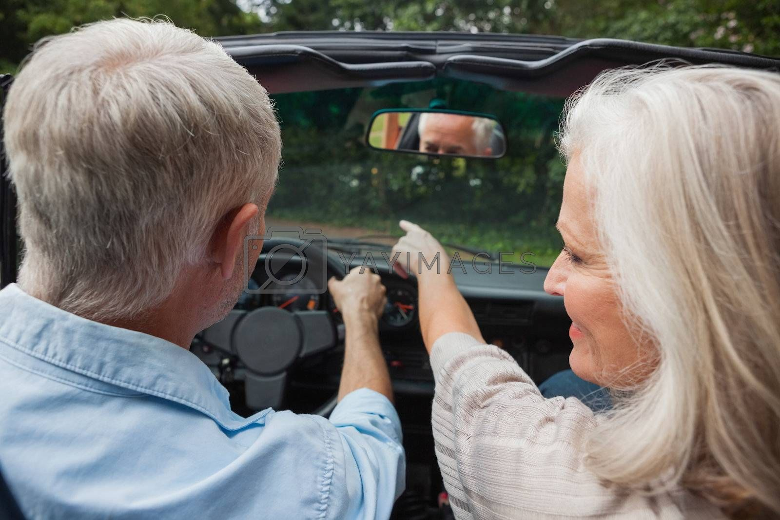 Rear view of smiling mature couple going for a ride together by Wavebreakmedia