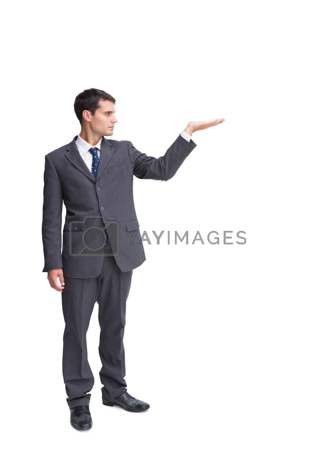 Businessman presenting something by Wavebreakmedia