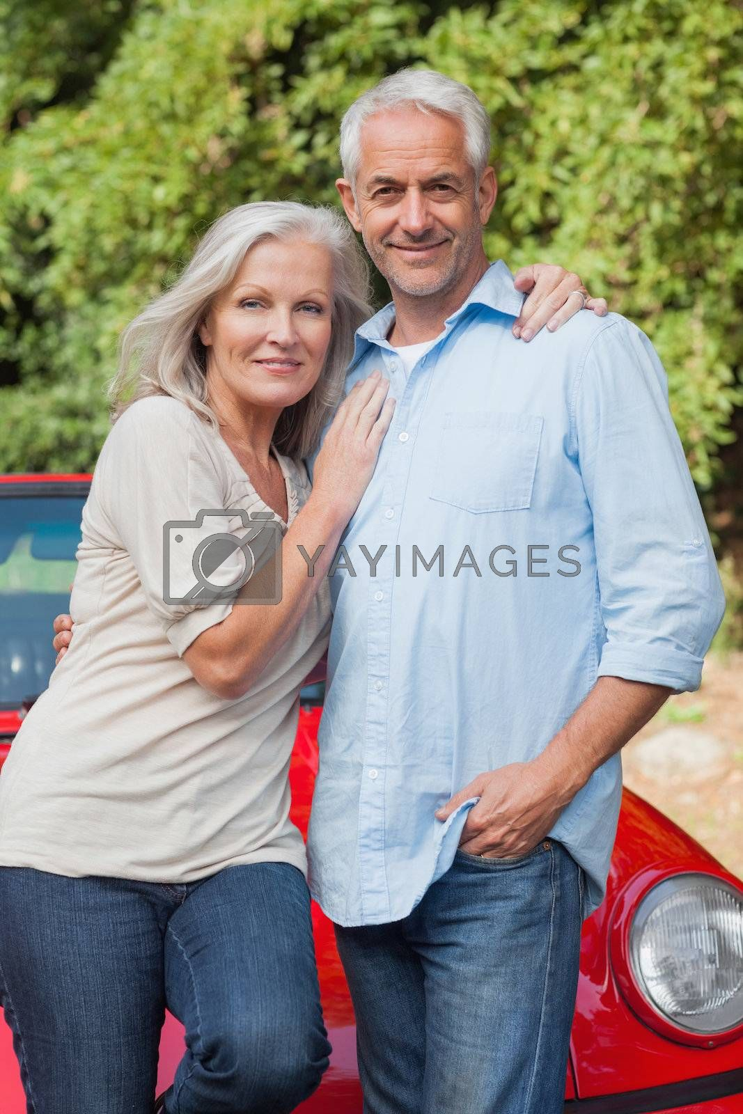 Smiling mature couple posing  by Wavebreakmedia