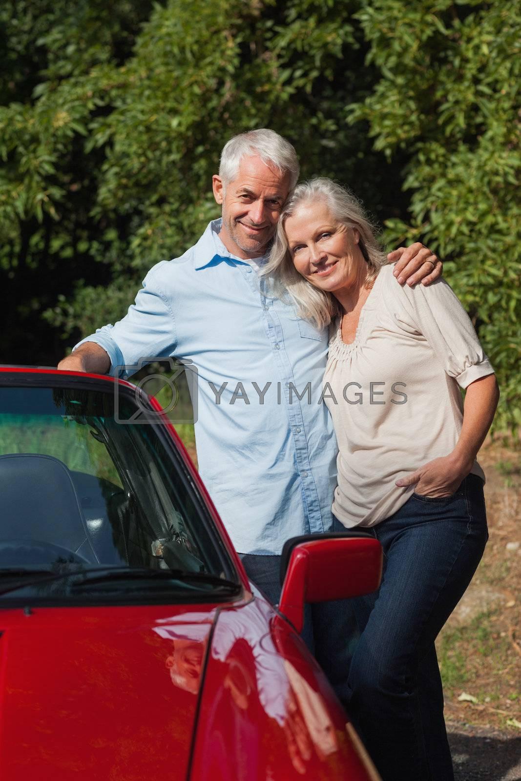 Happy mature couple posing  by Wavebreakmedia