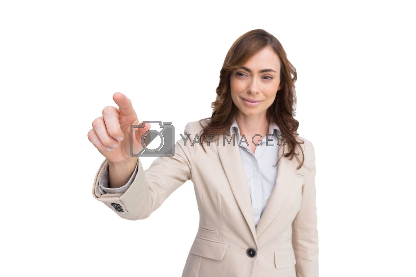 businesswoman touching invisible screen by Wavebreakmedia