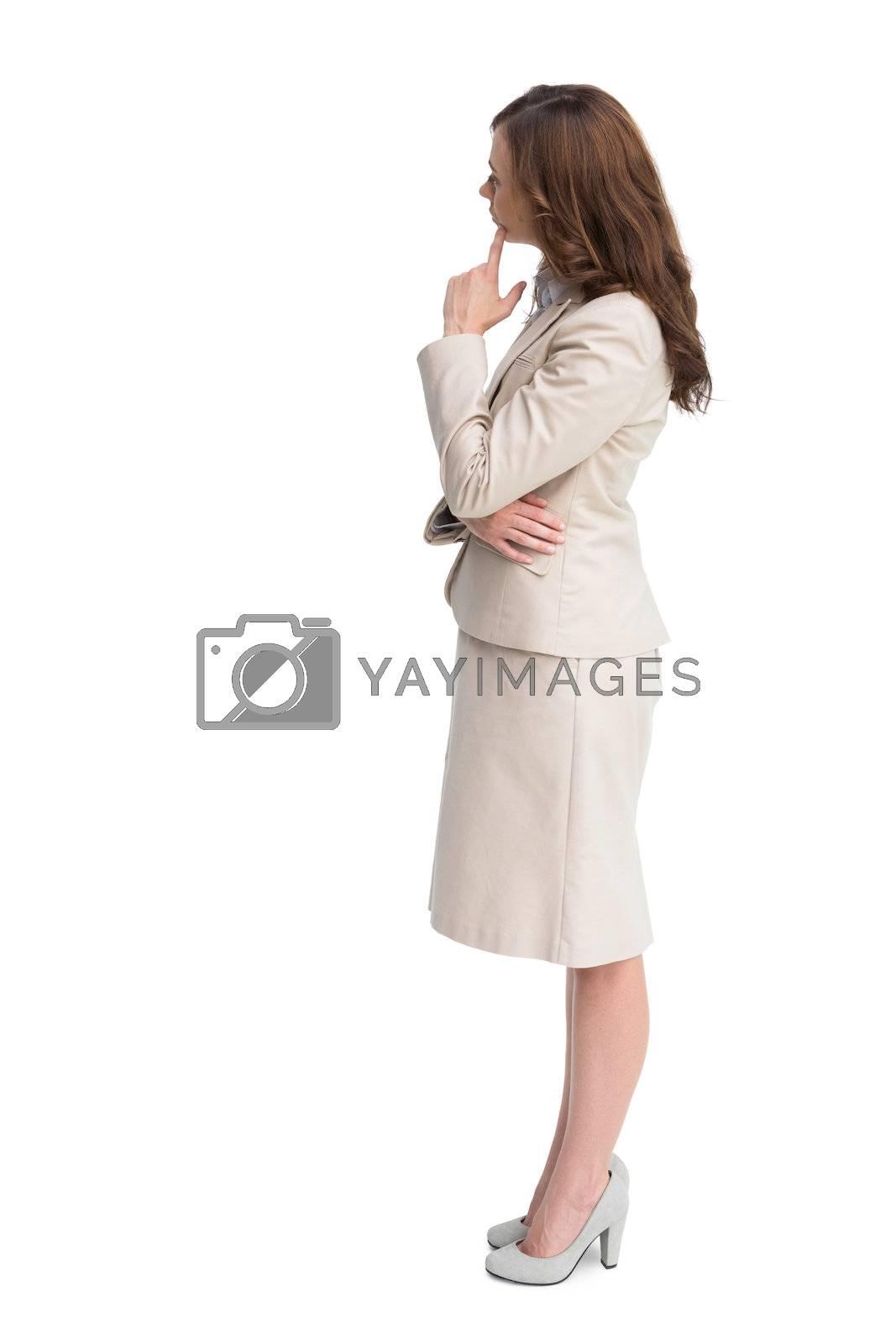 Profile view of doubtful businesswoman standing  by Wavebreakmedia