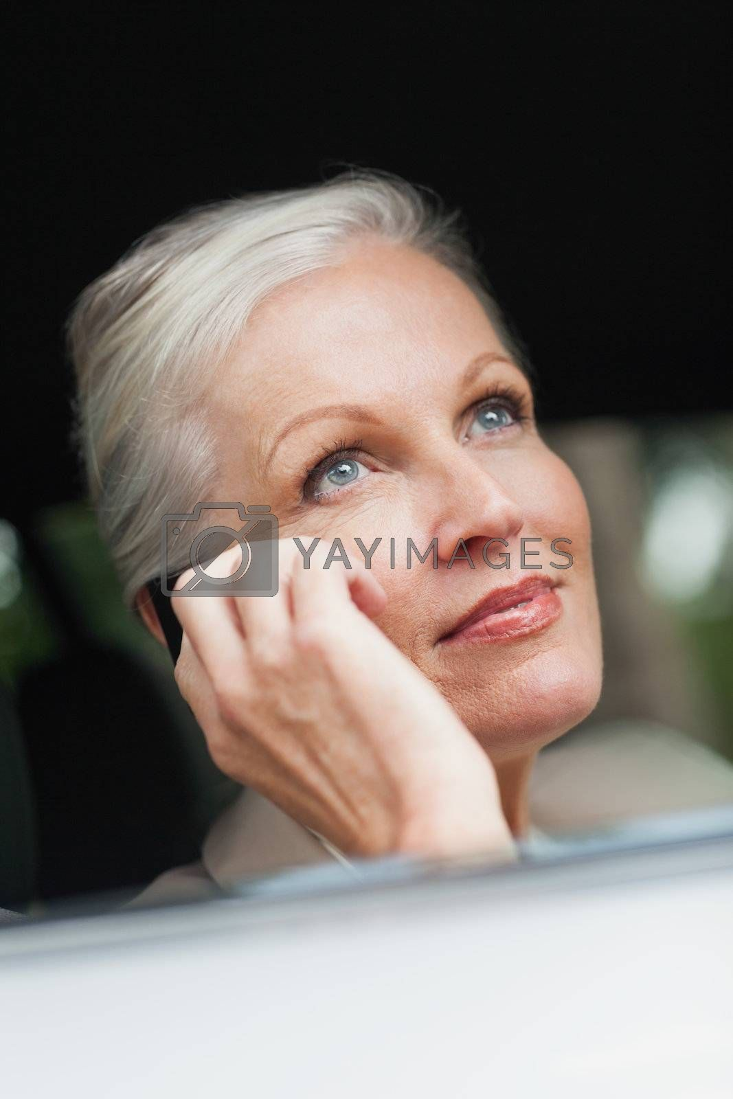 Businesswoman on the phone driving classy car by Wavebreakmedia