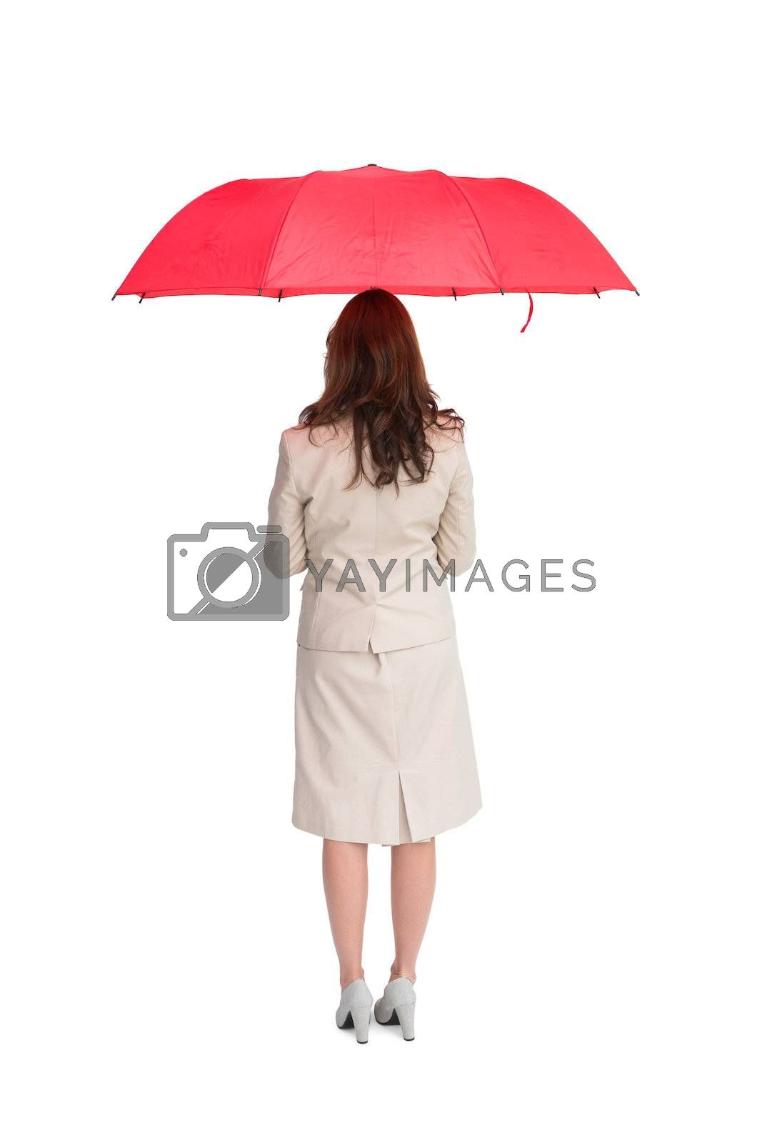 Businesswoman standing back to camera holding red umbrella by Wavebreakmedia