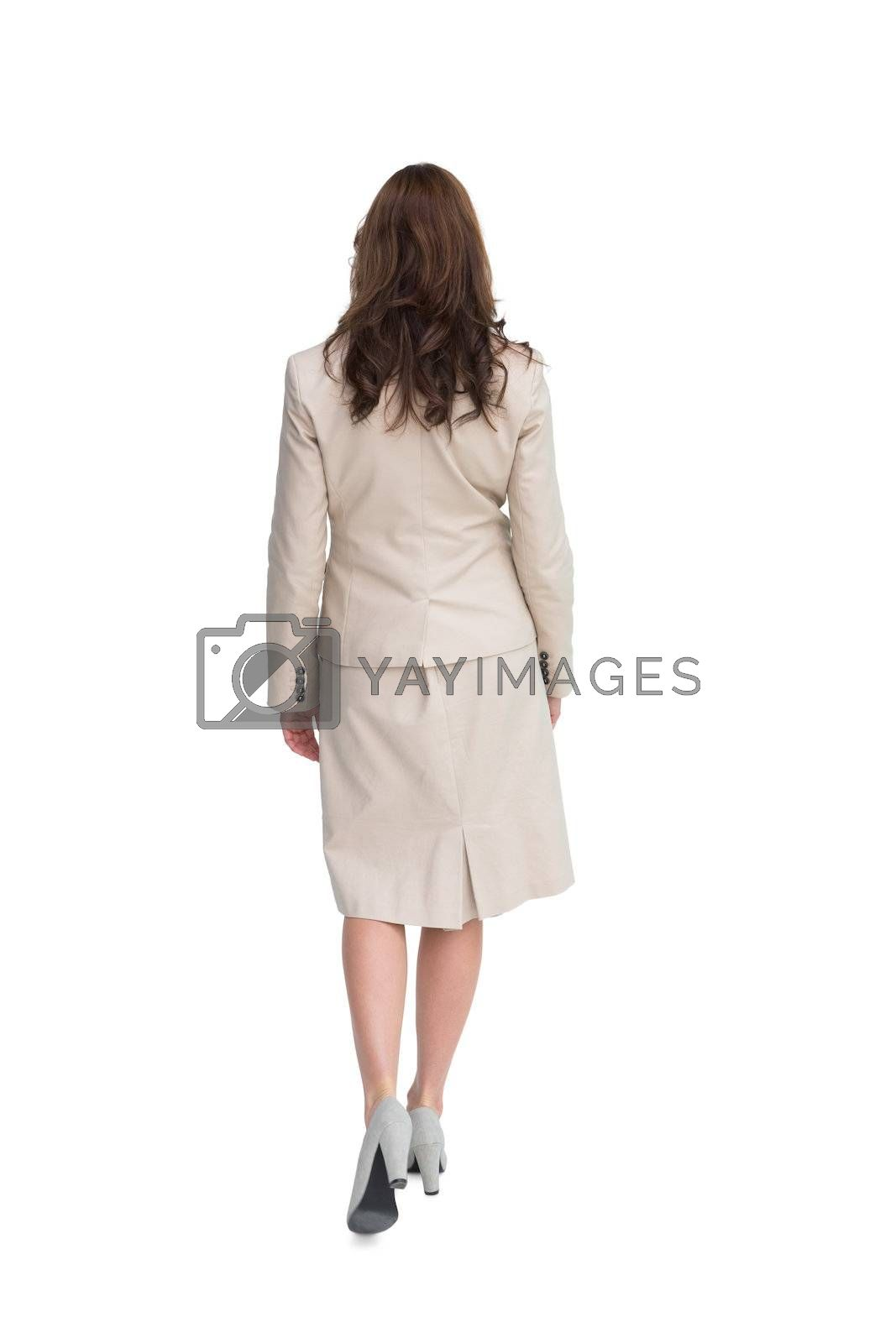 Classy businesswoman walking away from camera by Wavebreakmedia