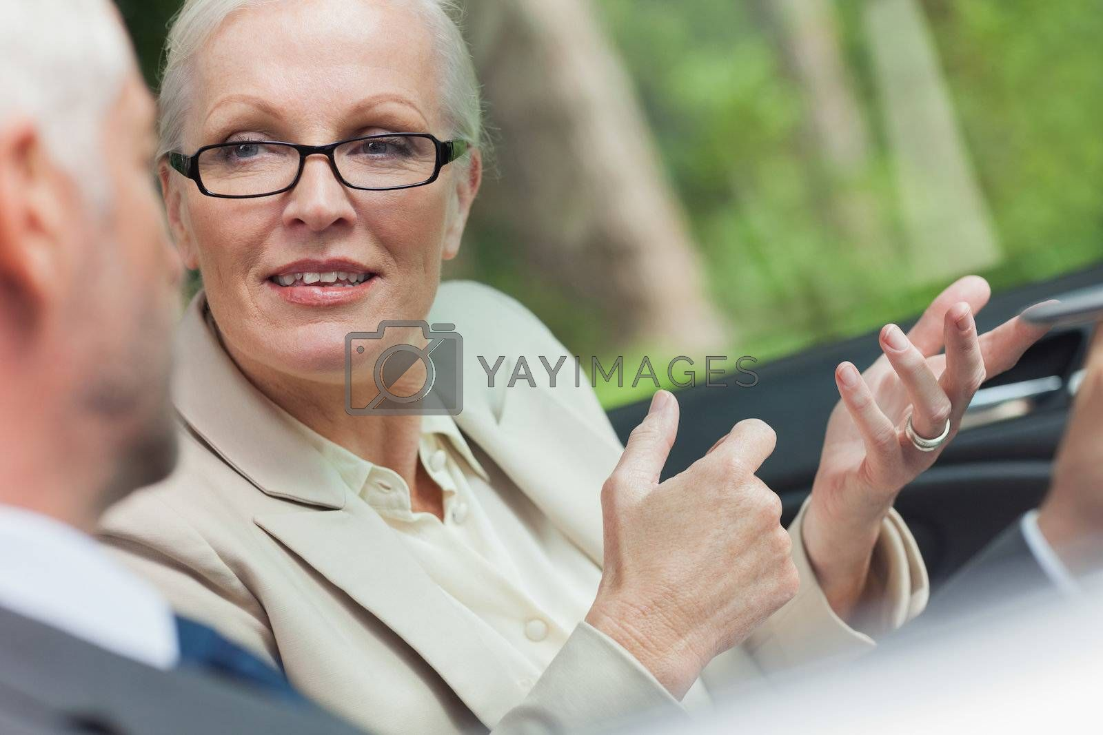 Business people working together in cabriolet by Wavebreakmedia