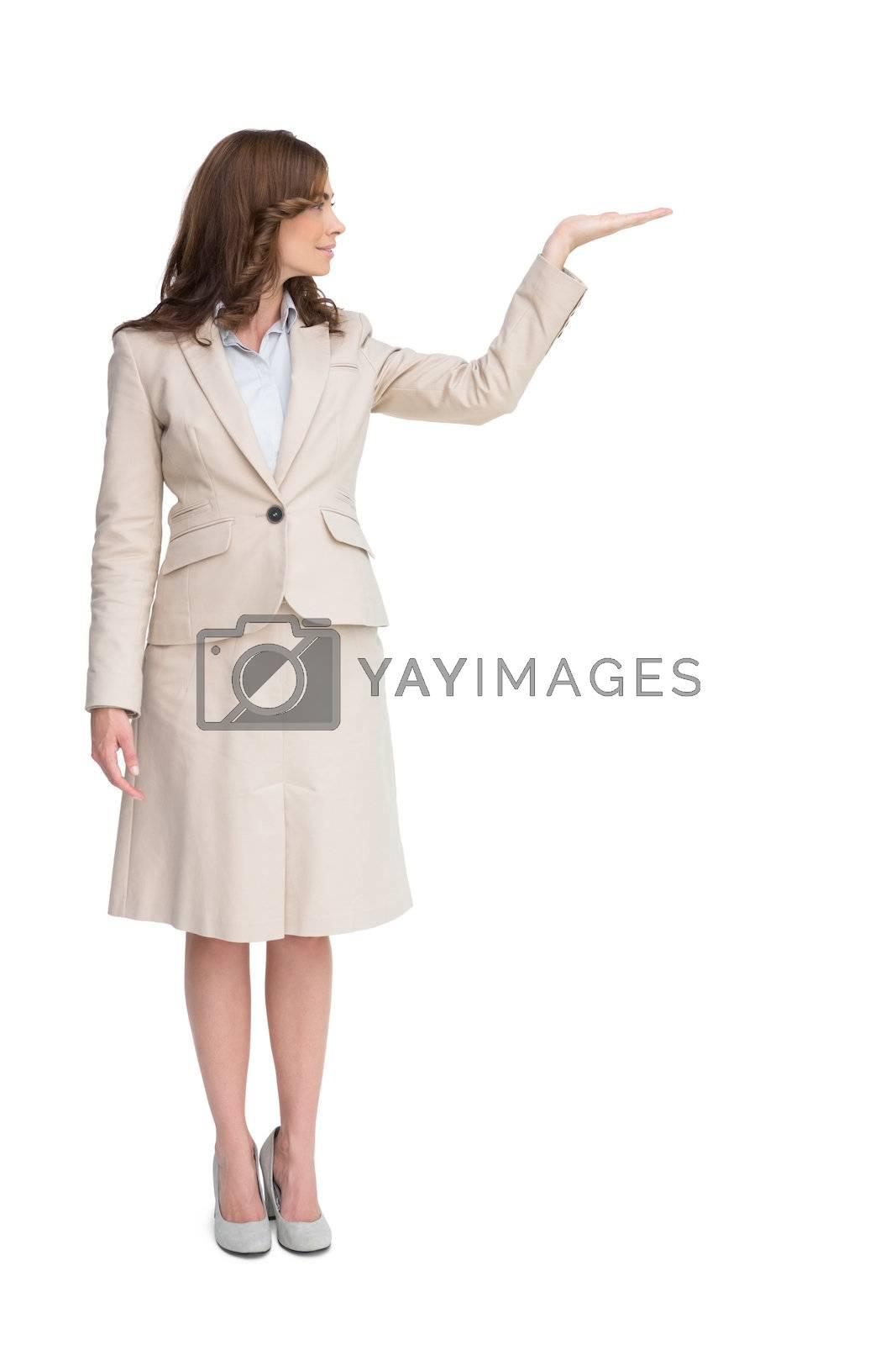 Businesswoman with empty hand open by Wavebreakmedia