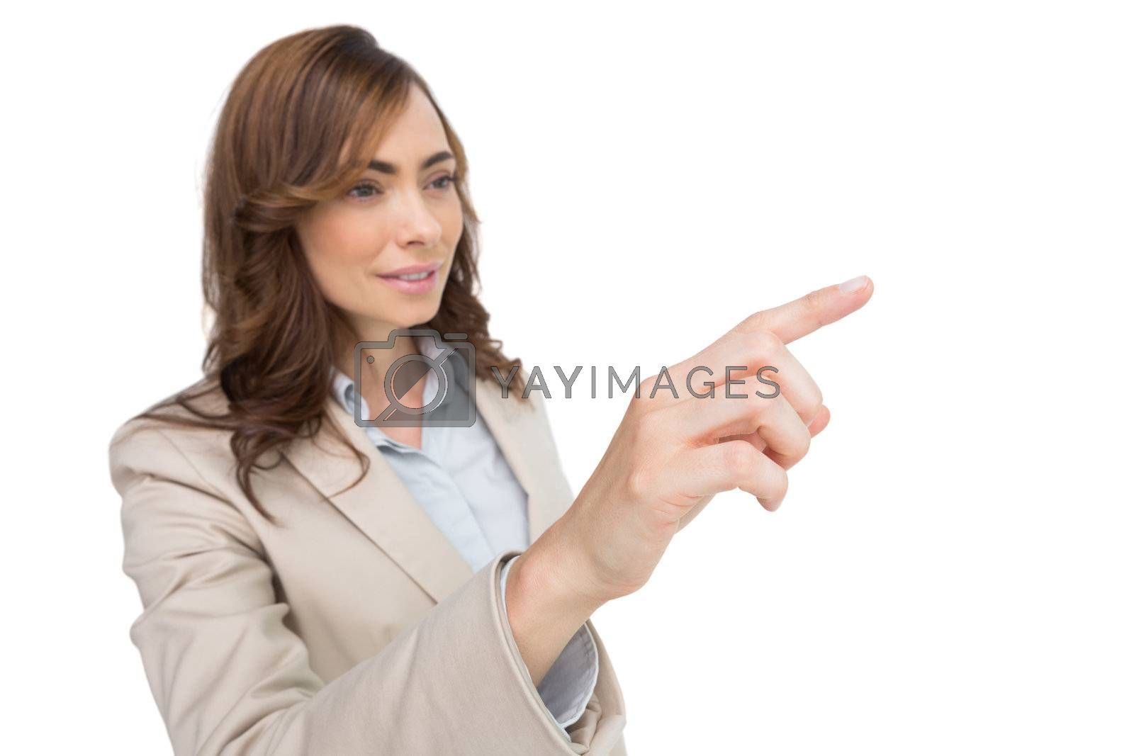Businesswoman pressing an invisible key by Wavebreakmedia