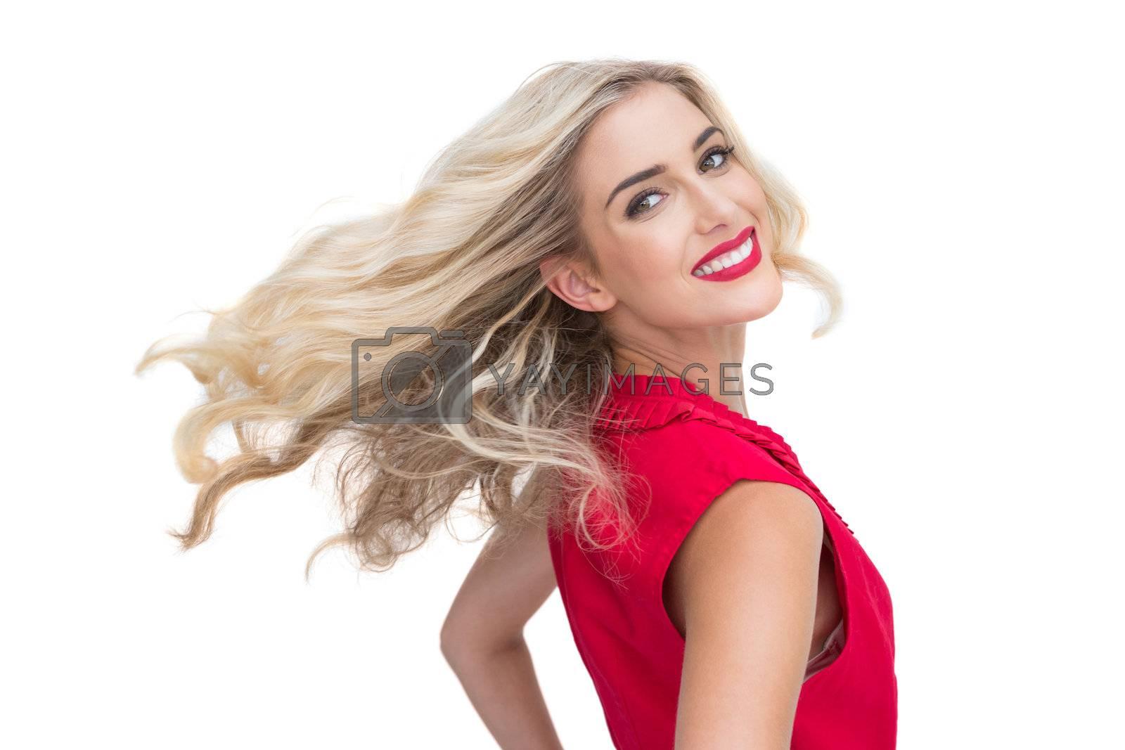 Smiling glamorous blonde posing by Wavebreakmedia