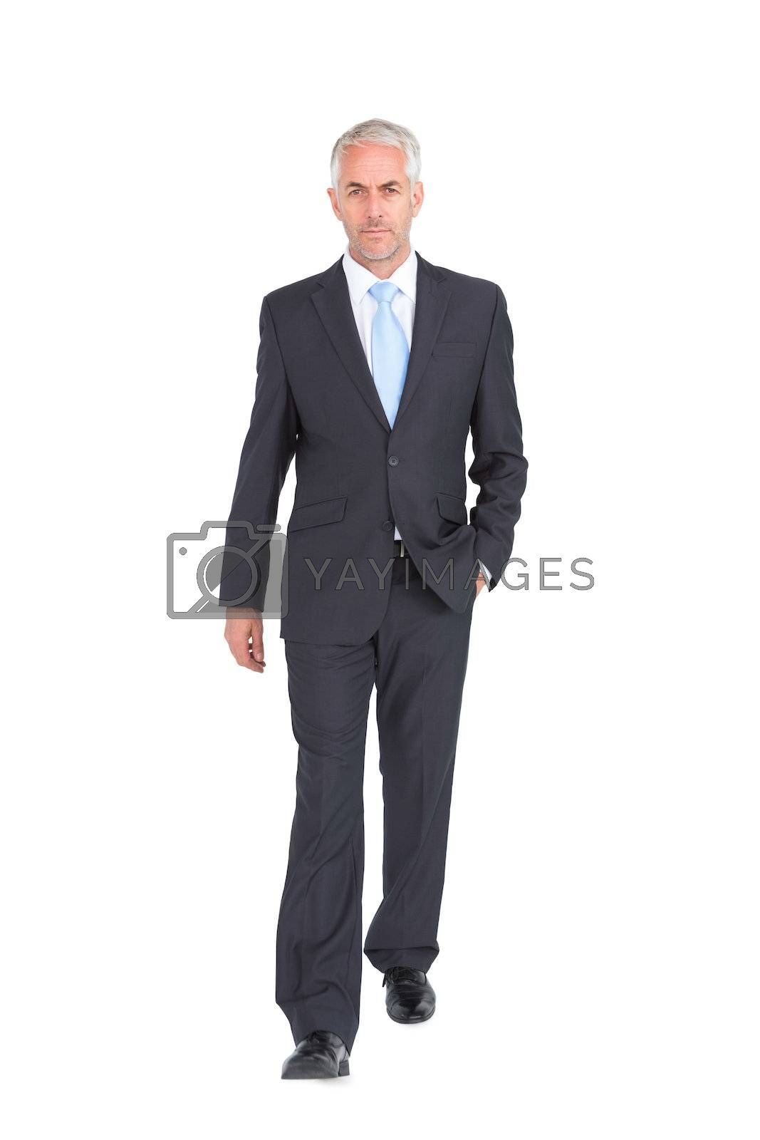 Businessman walking to camera by Wavebreakmedia