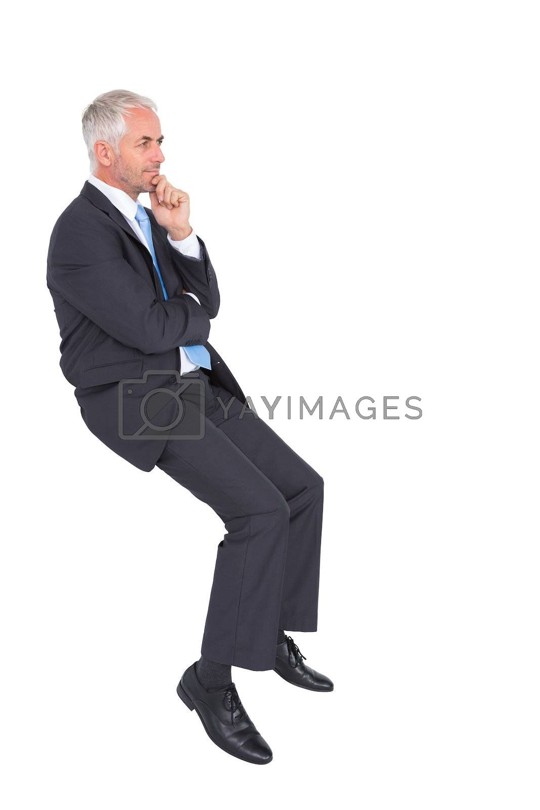 Businessman looking up while thinking by Wavebreakmedia