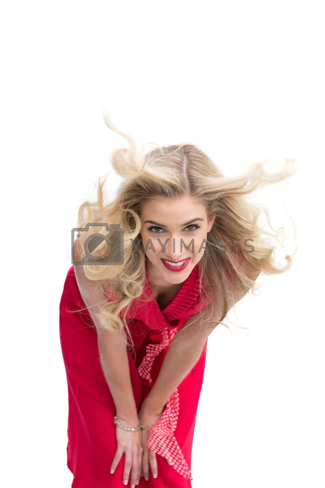 Smiling beautiful woman posing by Wavebreakmedia