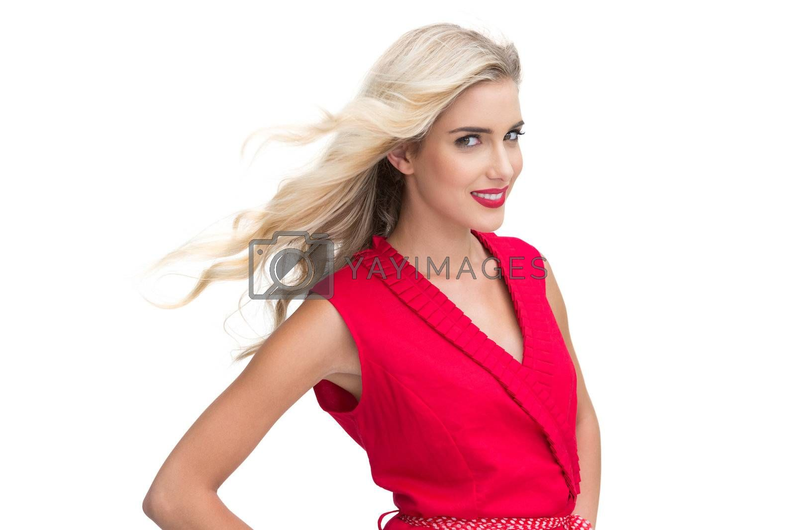 Woman wearing red dress smiling at camera by Wavebreakmedia