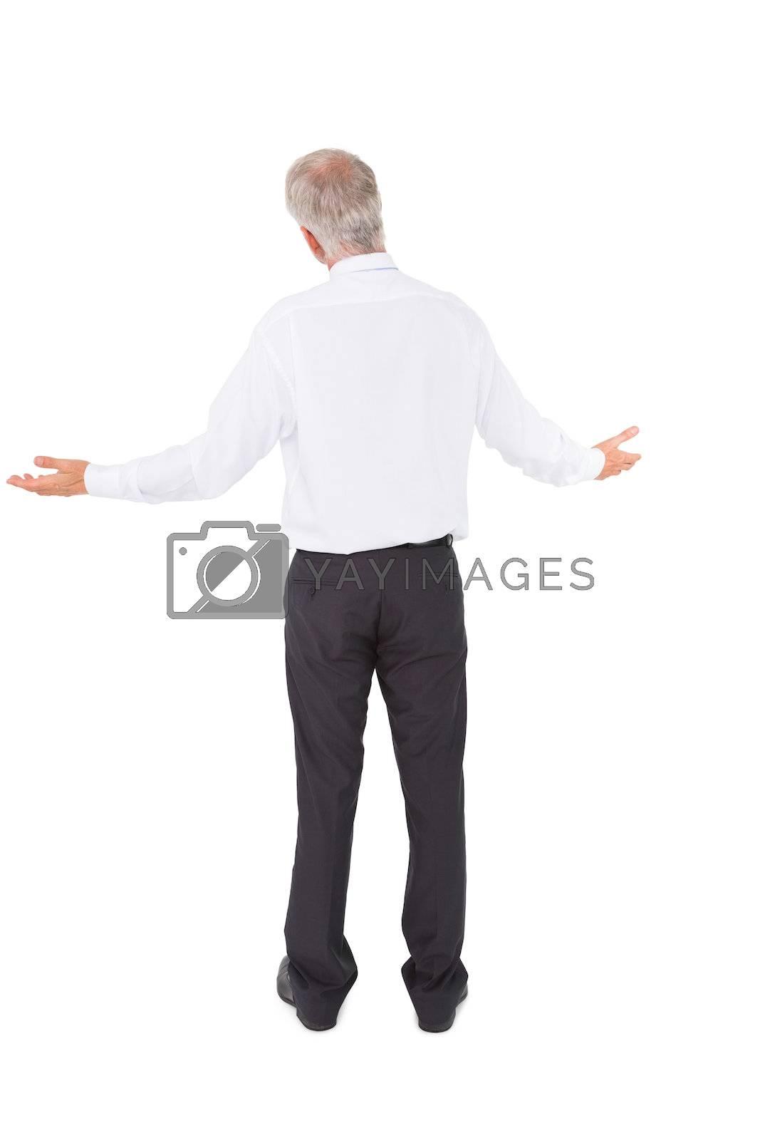 Rear view of surprised mature businessman posing by Wavebreakmedia