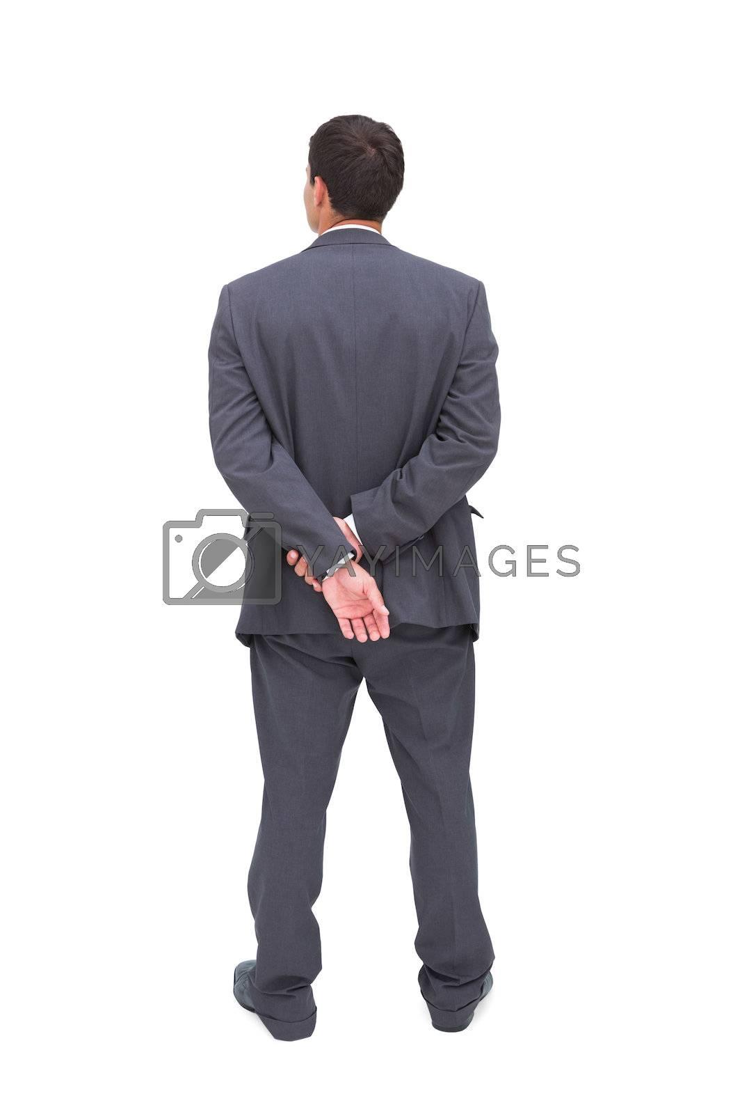 Rear view of classy businessman posing by Wavebreakmedia
