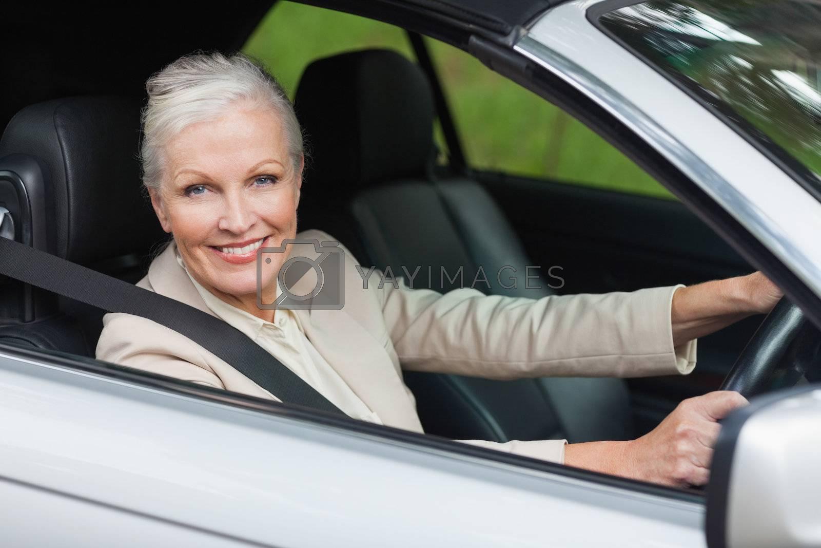 Cheerful businesswoman driving classy car by Wavebreakmedia