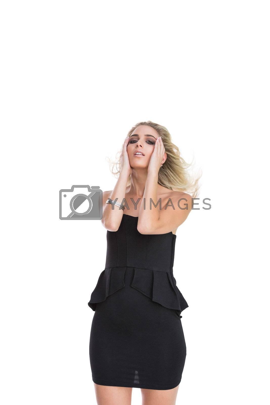 Gorgeous blonde wearing black dress  by Wavebreakmedia