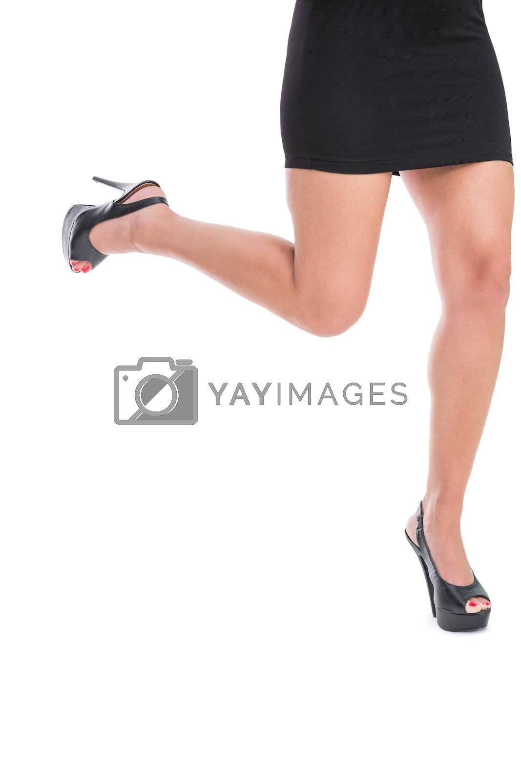 Close up on woman lifting up her leg by Wavebreakmedia