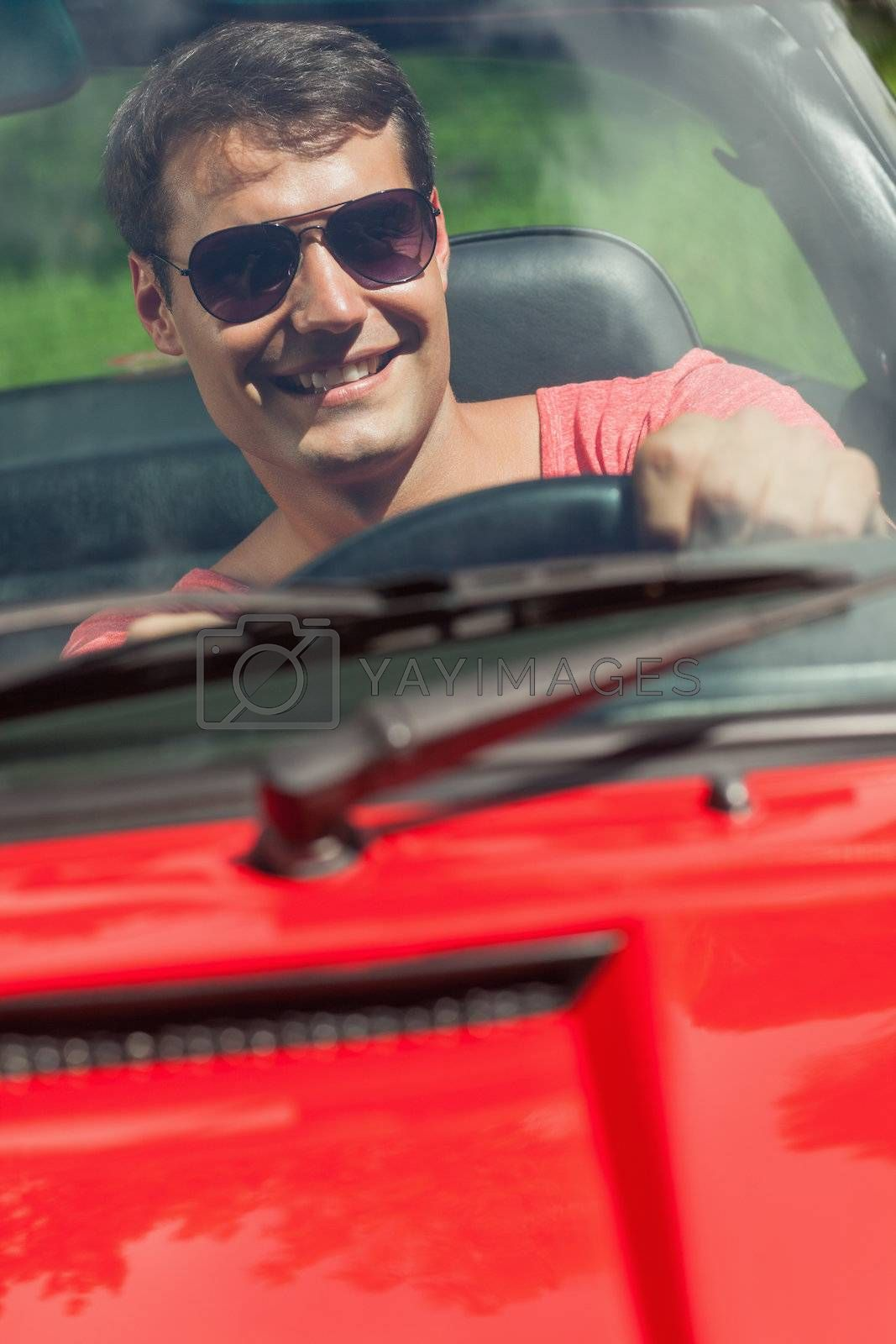 Cheerful handsome man driving his cabriolet by Wavebreakmedia
